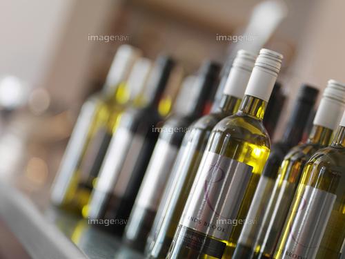 Bottles of white wine on a bar